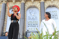A poet and an International artist VICKY SAMPSON, sings to the crowd of mourners. The City of Cape Town hosted an interfaith service on the Grand Parade as the day was declared a national day of prayer and reflection on the life of Nelson Mandela. Visitors also placed flowers and condolence messages on the barricade erected to accommodate it. Various religious leaders said prayers for the late South African President, Cape Town, South Africa, Sunday, 8th December 2013. Picture by Roger Sedres / i-Images