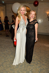 Left to right, EKATERINA FIELDS and ANNA DUROC-DANNER at the Gift of Life Old Russian New Year's Eve charity gala held at The Savoy Hotel, London on 13th January 2016.