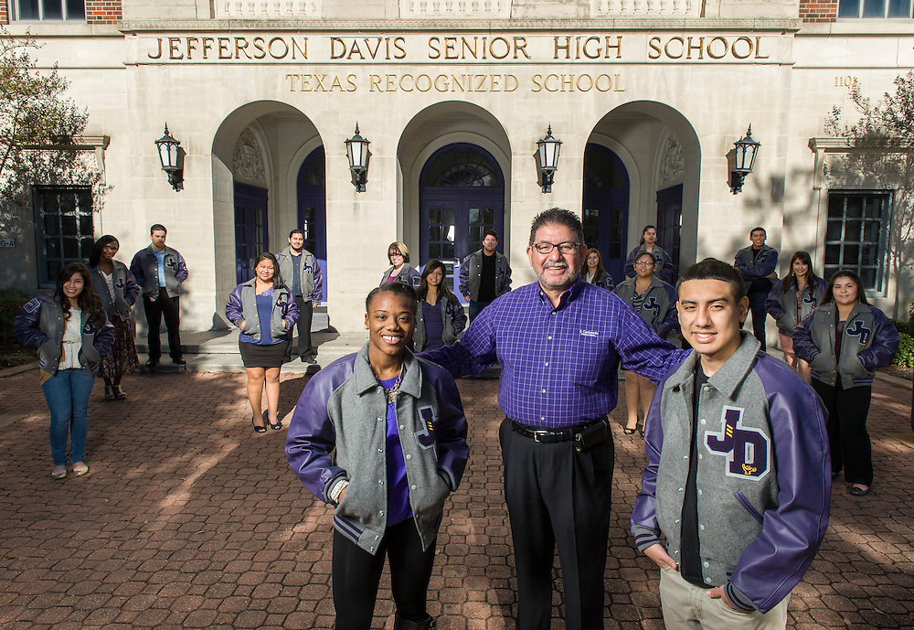 Principal Jamie Castaneda with some of the students who have earned academic letter jackets at Jefferson Davis High School, December 17, 2012, in Houston.