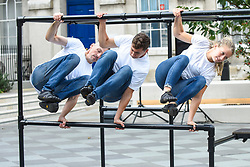 "© Licensed to London News Pictures. 10/10/2019. LONDON, UK.  (L to R) Alister O'Loughlin, Tim Merrifield and Grace Sellwood, members of the Urban Playground Parkour Team, rehearse ""Zoo Humans"" in the courtyard of Guy's Hospital adjacent to The Shard building to kick of the Dance Umbrella 2019 festival.  The show is inspired by the shocking statistic that three quarters of young people in the UK spend less time outdoors than prisoners  Photo credit: Stephen Chung/LNP"