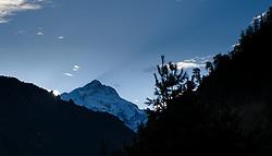 THEMENBILD - Trekkingtour in Nepal um die Annapurna Gebirgskette im Himalaya Gebirge. Das Bild wurde im Zuge einer 210 Kilometer langen Wanderung im Annapurna Gebiet zwischen 01. September 2012 und 15. September 2012 aufgenommen. im Bild der Gipfel des 8163 m hohen Manaslu kurz vor Sonnenaufgang, die Sonne wirft einen Schatten der Gipfelpyramide in den Himmel // THEME IMAGE FEATURE - Trekking in Nepal around Annapurna massif at himalaya mountain range. The image was taken between september 1. 2012 and september 15. 2012. Picture shows the summit of the 8163 m high Manaslu in the morning, NEP, EXPA Pictures © 2012, PhotoCredit: EXPA/ M. Gruber