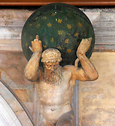 statue by Antonio Aspetti, depicting Atlas bending beneath the starry firmament. located on a terraced balcony in the Doge's Palace Courtyard, Venice. Built in Venetian Gothic style the palace was the residence of the Doge of Venice (the supreme authority of the rublic of Venice). It is now open as a museum.