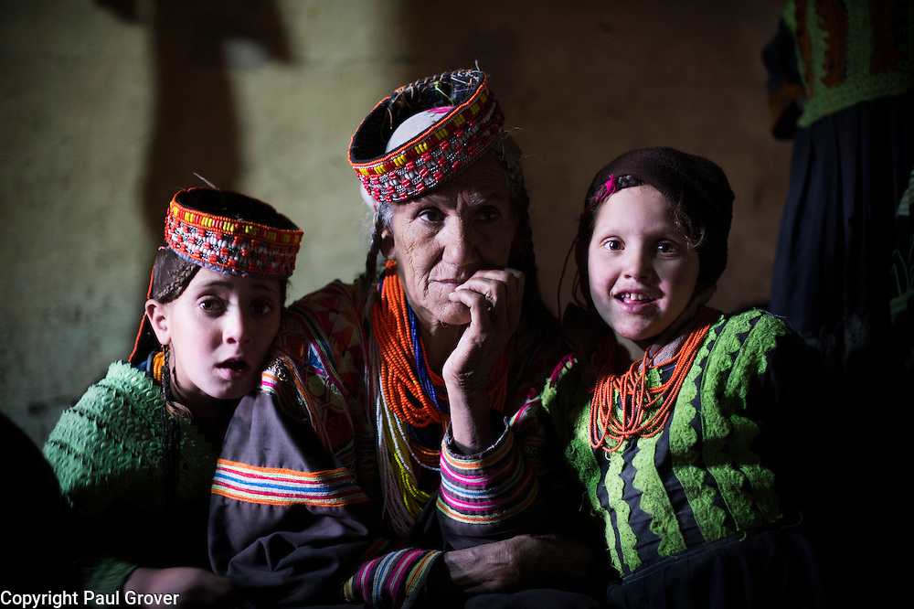 Bumburet, Chitral District,Pakistan.Pic Shows  Kalash woman and kids in the Kalash village in the valley of Bumburet