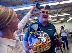 May 2, 2017 - Huntington Beach, California, USA - Gregory Paul Gardiner is all smiles as Jen Holst places Mickey ears on his head as part of a surprised while he receives a 2018 Teacher of the Year award from the Orange County Department of Education in Huntington Beach, California, on Tuesday, May 2, 2017. ..Gardiner, a high school biology teacher at Edison High School, is one of six teachers who were surprised with the honor by county superintendent of school Dr. Al Mija?res. ..(Photo by Jeff Gritchen, Orange County Register/SCNG) (Credit Image: © Jeff Gritchen, Jeff Gritchen/The Orange County Register via ZUMA Wire)