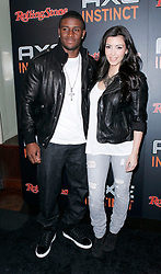 Kim Kardashian and Reggie Bush pose at the AXE Instinct and Rolling Stone Magazine 'The Power of Leather' event at the Hard Rock Cafe in Times Square New York City, USA on June 24, 2009. (Pictured : Kim Kardashian, Reggie Bush) Photo by donna ward/ABACAPRESS.COM  | 192968_008
