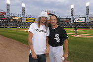 """CHICAGO - JULY 30:  Recording artist Kid Rock (L) poses for a photo with Omar Vizquel #11 of the Chicago White Sox before throwing out a ceremonial first pitch on """"Mullet Night"""" prior to the game between the Chicago White Sox and Oakland Athletics on July 30, 2010 at U.S. Cellular Field in Chicago, Illinois.  The White Sox defeated the Athletics 6-1.  (Photo by Ron Vesely)"""