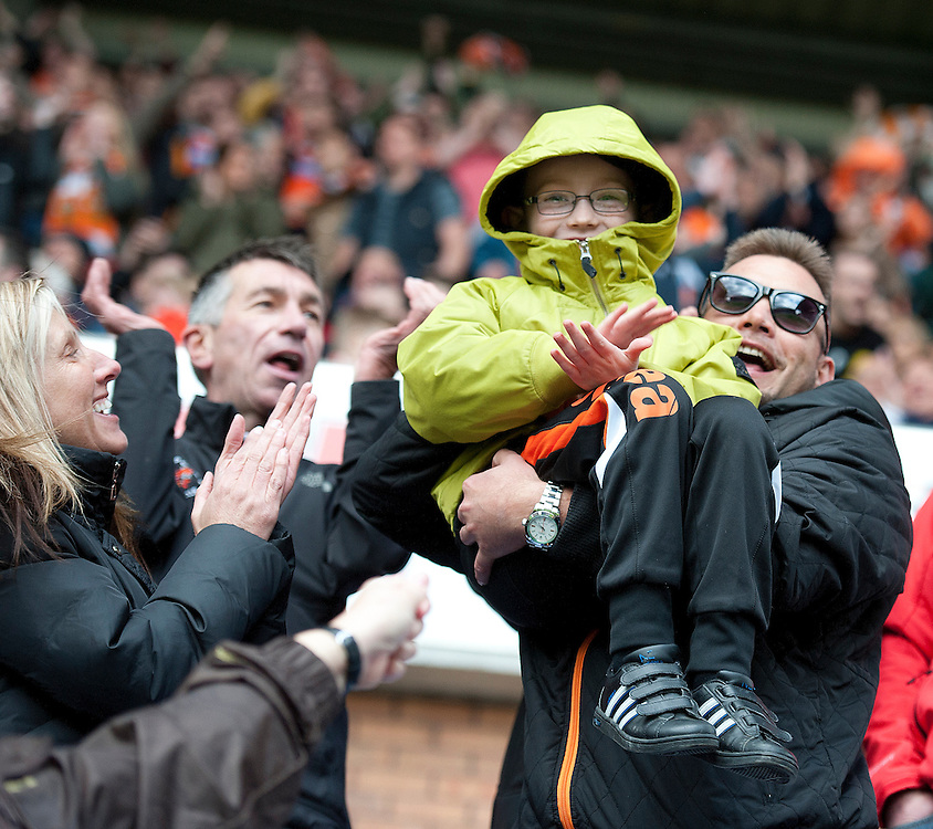 Blackpool fans celebrate their teams 2-0 victory at the final whistle<br /> <br /> Photo by Stephen White/CameraSport<br /> <br /> Football - The Football League Sky Bet Championship - Wigan Athletic v Blackpool - Saturday 26th April 2014 - DW stadium - Wigan<br /> <br /> © CameraSport - 43 Linden Ave. Countesthorpe. Leicester. England. LE8 5PG - Tel: +44 (0) 116 277 4147 - admin@camerasport.com - www.camerasport.com