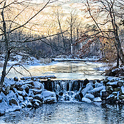 I love so many things about this image...the golden glow in the sky, the chill of the snow and ice, the water flowing and the depth across the pond to name a few.  Duke Farms, Hillsborough, NJ
