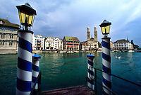 Dock on the Limmat River in front of Hotel zum Storchen (Grossmunster Church in background), Zurich, Switzerland