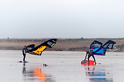© Licensed to London News Pictures. 15/11/2015. Porthcawl, Bridgend, Wales, UK. Good condition for Kite surfers at Rest Bay near Porthcawl. Photo credit: Graham M. Lawrence/LNP