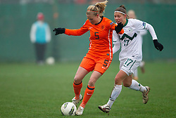 19-11-2011 VOETBAL: EK 2013 KWALIFICATIE VROUWEN: SLOVENIE - NEDERLAND: IVANCNA GORICA<br /> Anna van den Heiligenberg of Netherlands vs Urska Zganec of Slovenia during football match between Women national teams of Slovenia and Netherlands in 4th Round of EURO 2013 Qualifications<br /> ©2011-FotoHoogendoorn.nl/Vid Ponikvar