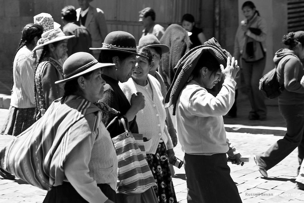 A group of quechua women walk to a street protest in Cusco, Peru