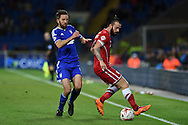 Cole Skuse of Ipswich (l) challenges John Brayford of Cardiff city. Skybet football league championship match, Cardiff city v Ipswich Town at the Cardiff city stadium in Cardiff, South Wales on Tuesday 21st October 2014<br /> pic by Andrew Orchard, Andrew Orchard sports photography.
