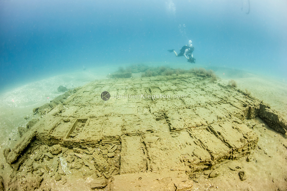 Underwater cinematographer Jason Sturgis films the wooden hull of the Encarnación, a 17th century cargo vessel that was part of the Spanish Tierra Firme fleet, in Panamanian waters.  The wreck was discovered during an expedition searching for Henry Morgan's lost fleet of 1671.