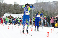 Gilford's Guy Rice and White Mountain's Jake Barker power out of the start for the 5 km NH Coaches Series race event on Saturday at the Gunstock Nordic Center in Gilford.  (Karen Bobotas/for the Laconia Daily Sun)