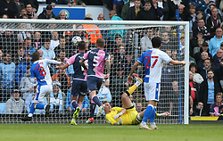 Blackburn Rovers' Joe Rothwell (left) scores the first goal of the game during the Sky Bet Championship match at Ewood Park, Blackburn. Picture date: Saturday October 16, 2021.