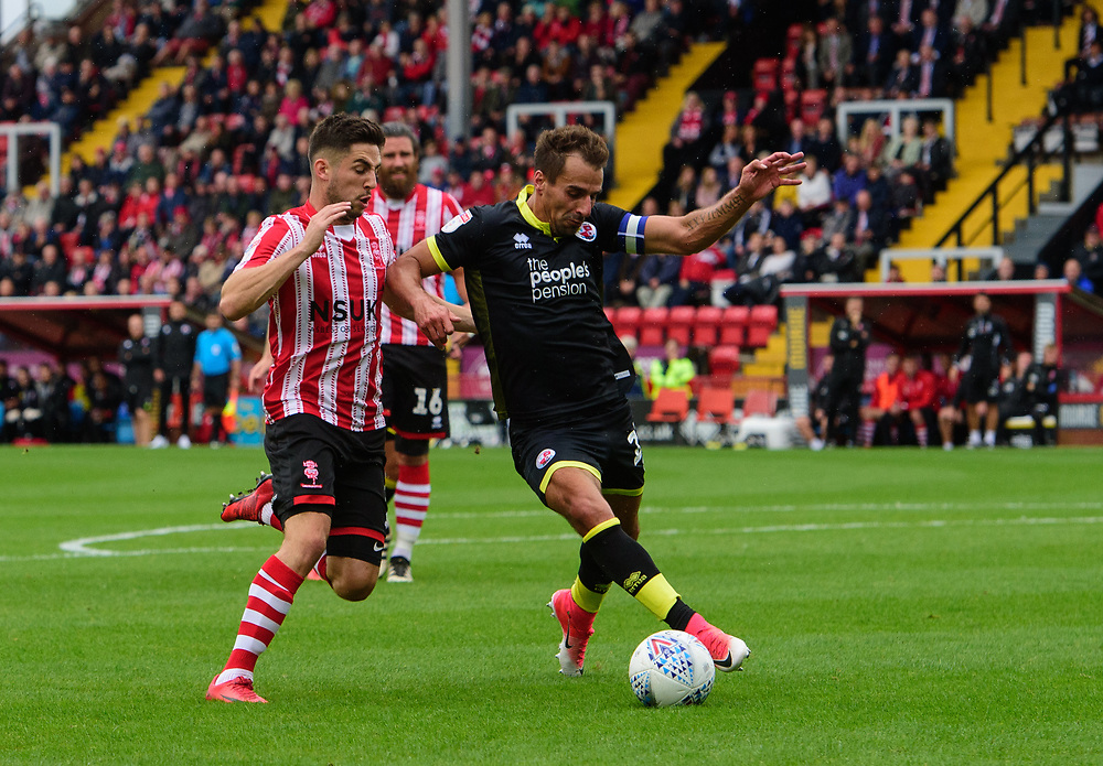 Lincoln City's Tom Pett vies for possession with Crawley Town's Filipe Morais<br /> <br /> Photographer Chris Vaughan/CameraSport<br /> <br /> The EFL Sky Bet League Two - Lincoln City v Crawley Town - Saturday September 8th 2018 - Sincil Bank - Lincoln<br /> <br /> World Copyright © 2018 CameraSport. All rights reserved. 43 Linden Ave. Countesthorpe. Leicester. England. LE8 5PG - Tel: +44 (0) 116 277 4147 - admin@camerasport.com - www.camerasport.com