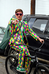 15 Feb 2015. New Orleans, Louisiana.<br /> Mardi Gras. Man in a Mardi Gras suit as The Krewe of Thoth rolls Uptown..<br /> Photo; Charlie Varley/varleypix.com