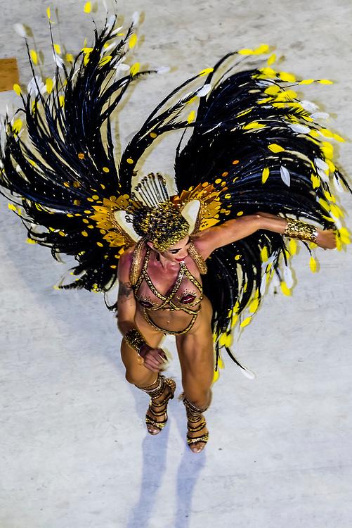 Samba dancer in the Carnaval parade of Inocentes de Belford Roxo samba school in the Sambadrome, Rio de Janeiro, Brazil.