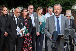 © Licensed to London News Pictures. 24/09/2021. Reading, UK. DCI Andy Howard from Thames Valley Police addresses the media in front of Amanda and Stuart Stephens and family outside Reading Crown Court following the sentencing of two teenager boys convicted of the murder and a teenaged girl convicted of manslaughter of Olly Stephens in Bugs Bottom fields, Emmer Green, Berkshire in January 2021. Photo credit: Peter Manning/LNP