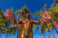 Statue of famous surfer Duke Kahanmoku holding leis on Waikiki Beach, Honolulu, Oahu, Hawaii, USA