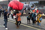 On the 10th consecutive day of protests around London by the climate change campaign Extinction Rebellion, a large inflatable elephant allows humour among protesters and passers-by, on 24th April 2019, at Marble Arch, London England.