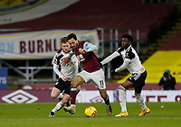 Football - 2020 / 2021 Premier League - Burnley vs. Fulham<br /> <br /> Dwight McNeil of Burnley goes past Harrison Reed and Josh Maja of Fulham in midfield, at Turf Moor.<br /> <br /> <br /> COLORSPORT/ALAN MARTIN