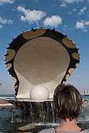 = sculpture of a pearl oyster onn The corniche  Doha  QATAR   la corniche  Doha  QATAR