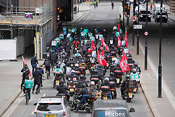 © Licensed to London News Pictures.  07/04/2021. London, UK. Deliveroo riders go through the streets of central London  to demand better pay, better rights & safety. Photo credit: Marcin Nowak/LNP