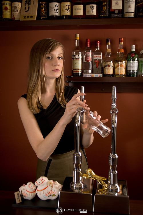 A young caucasian woman working in a bar in Osaka, Japan.
