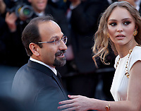 Director Asghar Farhadi and Lily-Rose Depp at the opening ceremony and Ismael's Ghosts (Les Fantômes D'ismaël) gala screening,  at the 70th Cannes Film Festival Wednesday May 17th 2017, Cannes, France. Photo credit: Doreen Kennedy