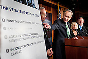 Senator Chuck Schumer (D-NY) points past Senate Majority Leader Harry Reid (D-NV) as Senators Patty Murray (D-WA) and Dick Durbin (D-IL) looks on during a press conference in the United States Capitol in Washington, D.C., U.S., on Wednesday, Oct. 16, 2013. Senators voted 81-18 to end the shutdown and avoid a possible default. The GOP-led House is expected to follow suit. Photographer: Pete Marovich/Bloomberg  *** Local Caption ***
