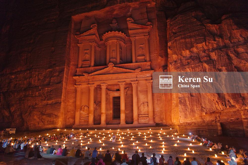 Night view of candles burning at Facade of Treasury (Al Khazneh), Petra, Jordan