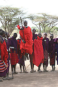 Africa, Tanzania, A group of Maasai men dancing a traditional dance An ethnic group of semi-nomadic people February 2006