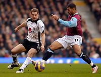 Photo: Alan Crowhurst.<br />Fulham v West Ham United. The Barclays Premiership. 23/12/2006. Fulham's Moritz Volz (L) with Hayden Mullins.