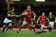 Jonathan Davies of Wales looks to break past South Africa's Jaque Fourie (l) and Pat Lambie. Autumn International rugby, 2013 Dove men series, Wales v South Africa at the Millennium Stadium in Cardiff,  South Wales on Saturday 9th November 2013. pic by Andrew Orchard, Andrew Orchard sports photography,