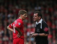 Photo: Andrew Unwin.<br />Liverpool v Everton. The Barclays Premiership. 25/03/2006.<br />Liverpool's Steven Gerrard is booked by the referee, Phil Dowd (R), for dissent.