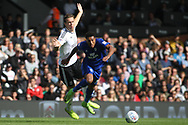 Kevin McDonald of Fulham (L) tackles Nathaniel Mendez-Laing of Cardiff City (R). EFL Skybet football league championship match, Fulham v Cardiff city at Craven Cottage in London on Saturday 9th September 2017.<br /> pic by Steffan Bowen, Andrew Orchard sports photography.