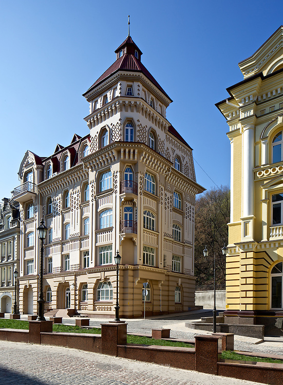 Vozdvizhenka residential real estate district in Kyiv, Ukraine. Daylight view of buildings with architectural details, portrait format.