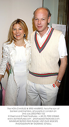 The HON.CHARLES & MRS HAMBRO, he is the son of banker Lord Hambro, at a party in London on 2nd July 2002.PBO 102