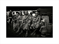 Monks waiting on the platform at Hua Lamphong train station in Bangkok. Opened in 1916 the iconic station is scheduled to close in 2021 and will be converted into a museum. This is one of my favorite images of monks because it portrays them in a non stereotypical situation.<br /> Purchase a signed and numbered limited edition fine art print of this image from www.hanskemp.com/store