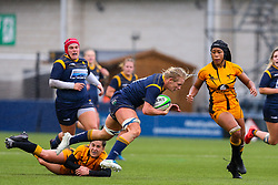 Alex Matthews of Worcester Warriors Women is tap tackled by Claudia MacDonald of Wasps FC Ladies - Mandatory by-line: Nick Browning/JMP - 24/10/2020 - RUGBY - Sixways Stadium - Worcester, England - Worcester Warriors Women v Wasps FC Ladies - Allianz Premier 15s