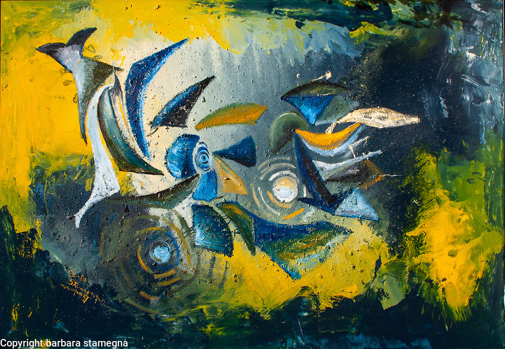 Blue, light pink, white, yellow, black, gray tones curved,  geometric  and circle shapes with concentric lines on mottled, colorful underwater like enamel background in rough texture and  blue, yellow and white tones shades and nuances.