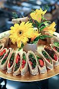 A serving dish with vegetarian Tortilla sandwich wraps