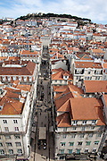 Rua de Santa Justa and part of the Baixa district, with the Castelo de S. Jorge on the top of the hill in the background, seen from the walkway at the top of Elevador de Sta. Justa, in central Lisbon.