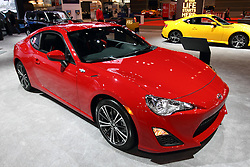 12 February 2015:  2015 SCION FR-S: A favorite among car enthusiasts, the Scion exciting FR-S sports coupe adds enhanced handling and stability for the 2015 model year. Scion explains that the letters 'FR-S' stand for Front-engine, Rear-wheel drive, and Sport. It's Scion's definition of an authentic rear-wheel drive sports car. Pop the hood, and examine the 2.0-liter, naturally aspirated four-cylinder engine that is the result of a joint development between Toyota and Subaru. The flat-four creates a 12.5:1 compression ratio, as well as an impressive 200 horsepower and mated to either a six-speed manual gearbox or a six-speed automatic transmission with paddle shifters and Dynamic Rev Management technology. The FR-S's low weight (2,758 with manual to 2,806 pounds with automatic) is complimented by a dynamically tuned suspension setup. The fierce exterior of the FR-S is remarkably sleek and low, with a menacing face, aggressive sporty dual exhaust system and LEDs illuminate the edgy taillights. New this model year is a more streamlined shark-fin antenna, auto on/off headlights and new key design. Opening the door reveals a low and comfortable 2+2 passenger cockpit, displaying a large center-mounted tachometer, the focus of the three-gauge cluster. The FR-S is available in seven colors including Raven, Asphalt, Hot Lava, Ultramarine and Firestorm. For 2015, Halo replaces Whiteout for the exterior pearl white paint for an additional $395 fee, and Steel replaces Argento as a silver color. The compact FR-S is Scion's new halo car, expanding the brand into a new dimension of driving performance.<br /> <br /> First staged in 1901, the Chicago Auto Show is the largest auto show in North America and has been held more times than any other auto exposition on the continent. The 2015 show marks the 107th edition of the Chicago Auto Show. It has been  presented by the Chicago Automobile Trade Association (CATA) since 1935.  It is held at McCormick Place, Chicago Illinois