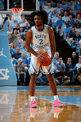 CHAPEL HILL, NC - FEBRUARY 05: Coby White #2 of the North Carolina Tar Heels carries the ball during a game against the North Carolina State Wolfpack on February 05, 2019 at the Dean Smith Center in Chapel Hill, North Carolina. North Carolina won 113-96. North Carolina wore retro uniforms to honor the 50th anniversary of the 1967-69 team. (Photo by Peyton Williams/UNC/Getty Images) *** Local Caption *** Coby White