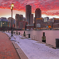 Boston Ablaze featuring winter Boston Harbor skyline photography from New England Photography Guild member and award winning fine art photographer Juergen Roth showing Boston Financial Waterfront District landmarks such as One International Place, Boston Harbor Hotel, Independence Wharf, Department of Homeland Security building, and other structures along Rowes Wharf photographed on a beautiful winter sunset evening. The last light was painting the cloudscape in fire red hues and the long exposure time ensured the intentional blurry cloud movement. <br /> <br /> Skyline photos of Boston are available as museum quality photo prints, canvas prints, wood prints, acrylic prints or metal prints. Fine art prints may be framed and matted to the individual liking and decorating needs:<br /> <br /> http://juergen-roth.pixels.com/featured/boston-ablaze-juergen-roth.html<br /> <br /> All digital Boston skyline photography images are available for photo image licensing at www.RothGalleries.com. Please contact me direct with any questions or request.<br /> <br /> Good light and happy photo making!<br /> <br /> My best,<br /> <br /> Juergen<br /> Prints: http://www.rothgalleries.com<br /> Photo Blog: http://whereintheworldisjuergen.blogspot.com<br /> Instagram: https://www.instagram.com/rothgalleries<br /> Twitter: https://twitter.com/naturefineart