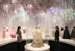 Gallery assistants look at the Christian Dior by Maria Grazia Chiuri (b. 1964), Haute Couture, Spring/Summer 2017 'Jardin Fleuri' dress during the preview into the 'Christian Dior: Designer of Dreams' at the Victoria and Albert Museum, London. Picture dated: Wednesday January 30, 2019. Photo credit should read: Isabel Infantes / EMPICS Entertainment.