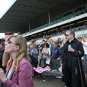 Punters, including a 'man of the cloth'  watching the racing at Belmont Park during the Jockey Club Gold Cup Day, Belmont Park, New York. USA. 28th September 2013. Photo Tim Clayton